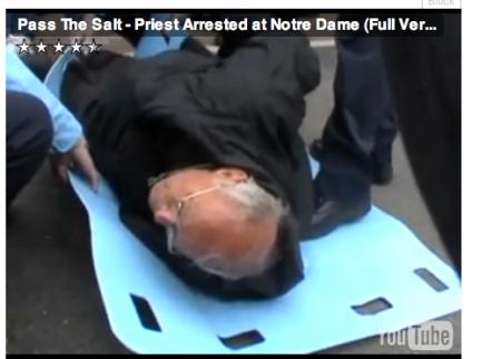 Fr Weslin handcuffed